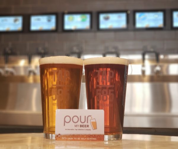 Two craft beer glasses at Tap 585 with a PourMyBeer Self-Serve Card