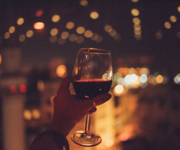 person-holding-cup-of-wine-1841591