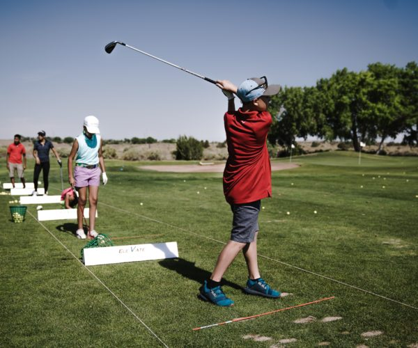 person-swinging-golf-club-on-field-1325659