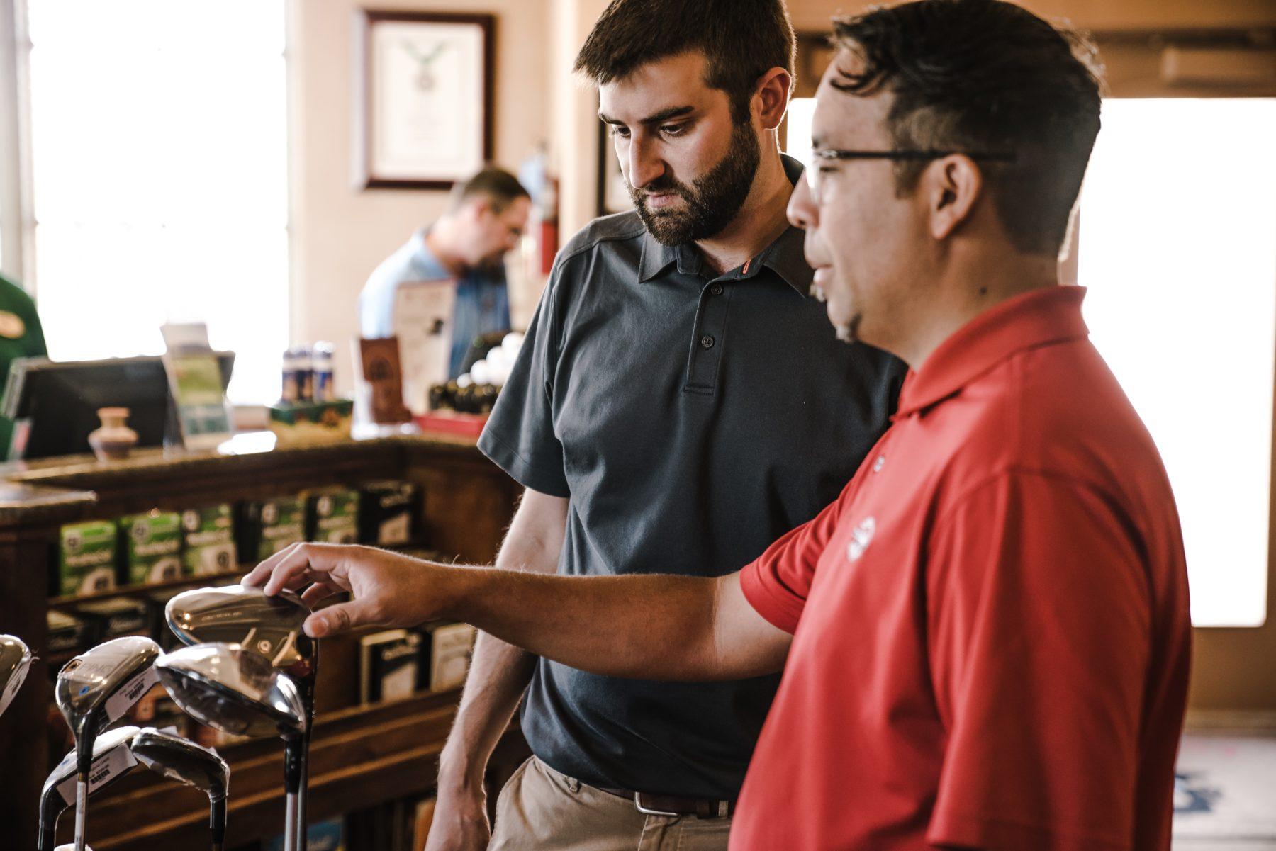 two-man-standing-near-golf-clubs-1325722