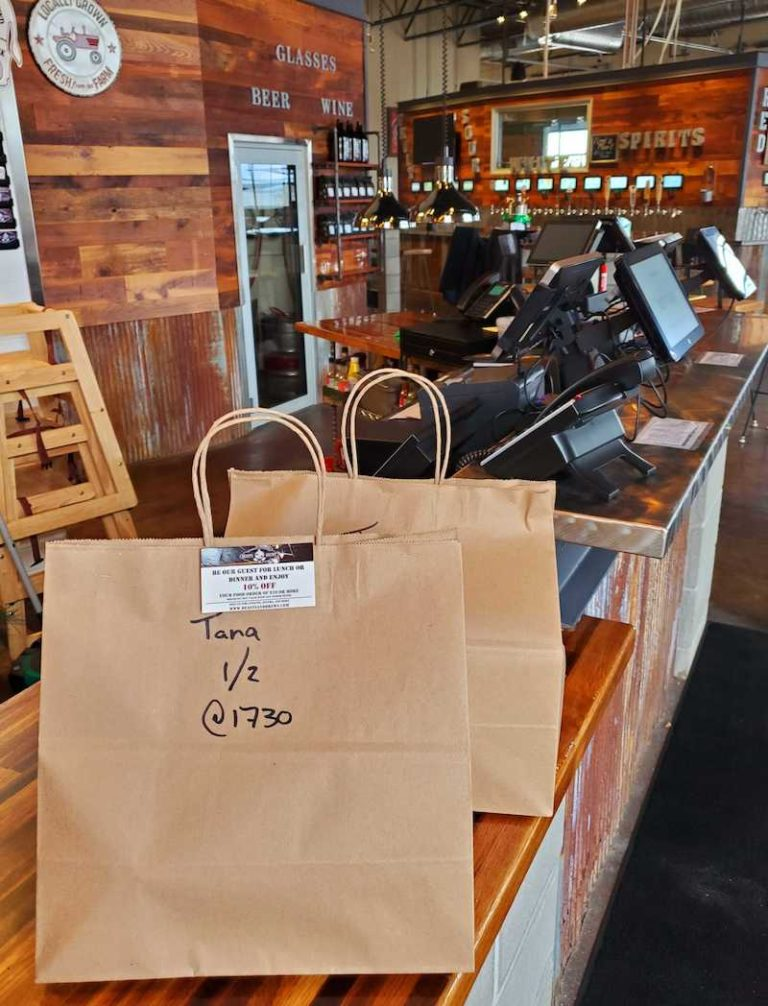 Bar offering bags of takeout during shutdown.
