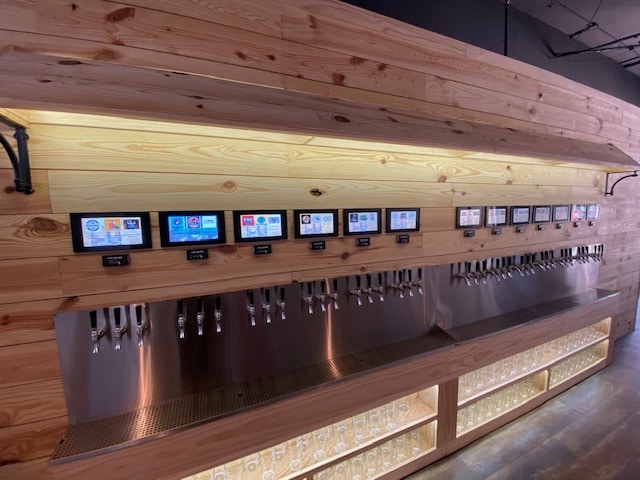 self-pour beverage wall at Pour Smart Bar