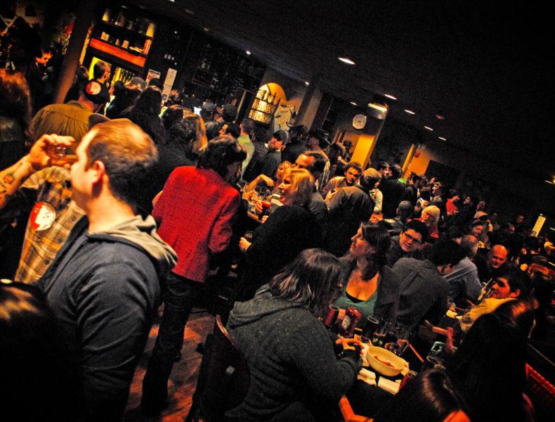 crowd gathered at a bar