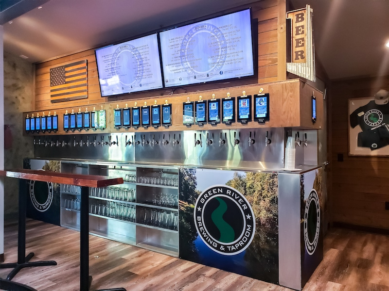 PourMyBeer wall with drink menu at the top