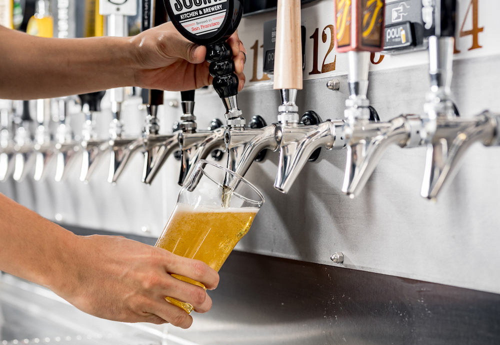 pouring beer with PourMyBeer self-pour system