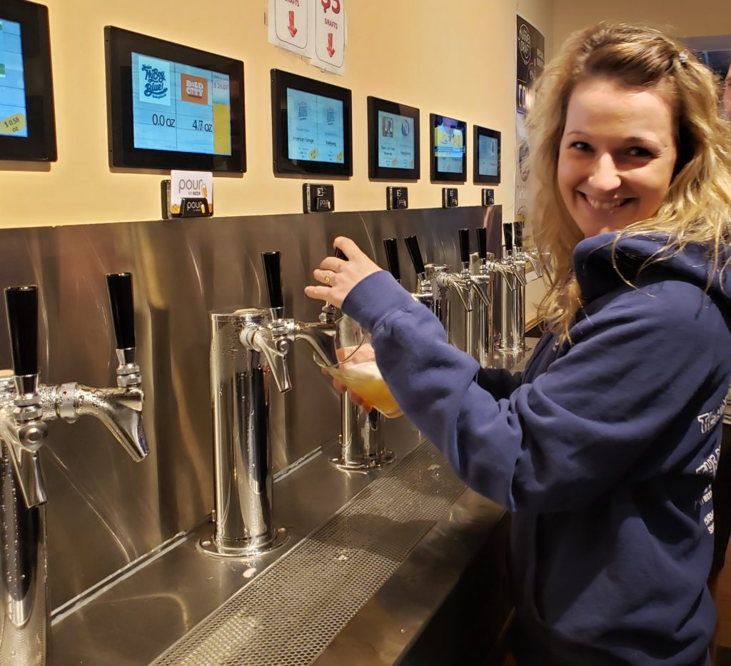 Happy Customer Pouring From Auggie's Self-Serve PourMyBeer Beverage Wall