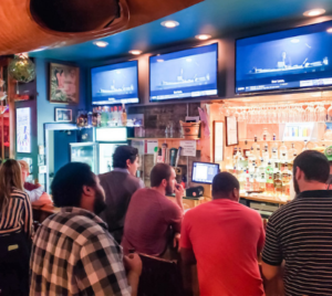 Busy traditional bar with long wait times