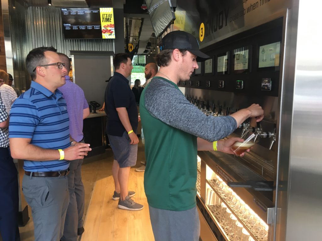 Customers pouring from PourMyBeer Wall at Buffalo Wild Wings Express