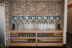 PourMyBeer self-serve beverage wall at Pizza Artista, Greenville
